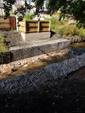 New gabions standing on the concrete foundations