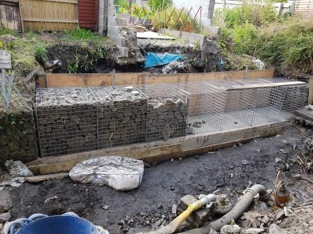 Progress of the gabions being filled